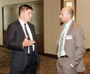 Matt Hayes, left, of Wells Fargo Insurance Services of West Virginia, Inc. chats with Chris Fiumara of Massaro Corporation prior to the Energy Leadership Awards May 17, 2012.