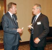Andy Redinger, left, of Key Bank chats with Dave Berthelsen of EverPower Wind Holdings prior to the Energy Leadership Awards May 17, 2012.