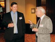 Andrew Allen, left, of Nemacolin Woodlands Resort chats with Chris Davis of Bluestone Energy Advisors prior to the Energy Leadership Awards May 17, 2012.