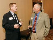 Thorne King, left, of BPL Global, Ltd. chats with Robin Zoufalik of RZ-tek Solutions LLC prior to the Energy Leadership Awards May 17, 2012.