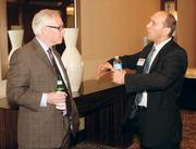 John McCarthy, left, of Chapman Corporation chats with Tim Davidson of Brothers Lazer Service, Inc. prior to the Energy Leadership Awards May 17, 2012.