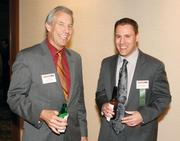 Lee Shull, left, of Resources Global Professionals chats with Preston Poljak of Peoples Natural Gas prior to the Energy Leadership Awards May 17, 2012.