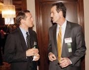 Douglas King, left, of Gleason & Associates, PC chats with Dan Deiseroth of  The Gateway Engineers, Inc. prior to the Energy Leadership Awards May 17, 2012.