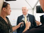 Gov. Corbett talks to the media after the groundbreaking at Hormann Flexon. Corbett addressed the audience about Washington County and Pennsylvania's place in the world.
