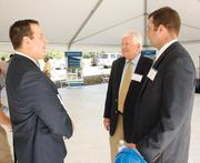 John Hess, left, of Dynamic Building Corporation chats with Richard White, center, of The Washington County Council on Economic Development and Patrick Morosetti of Fourth River Development LLC following a groundbreaking ceremony Monday, July 9, 2012 for Hormann Flexon LLC at Starpointe Business Park in Burgettstown, Washington County.
