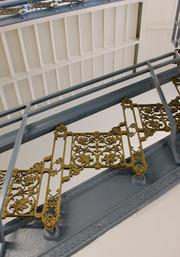 Wrought iron railing in the stairwells remains at Residences at South High.