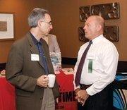 Patrick Ferraro, left, of Career Development Center, chats with Robert Drelick of First Niagara Bank NA.