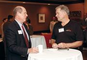 Ken Janowitz, left, of Premium Plastic Solutions LLC, chats with Emil Heintzinger of LegalShield.