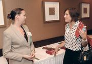 Julia Johnson, left, of Louis Plung & Co. LLP chats with Gina Costic of Phipps.
