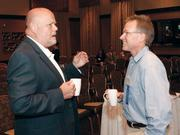 Thomas Windfelder, left, of TBrooks chats with Dave Nelsen of Dialog Consulting Group prior to the Business For Breakfast event at Restaurant Echo in Cranberry.