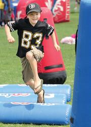 Christian Dailey of Wintersville, Ohio, runs through the Steelers obstacle course at the UPMC Steelers Experience, the team's interactive theme park located near football practice fields.