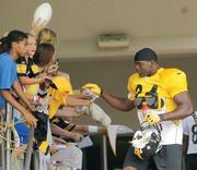 Pittsburgh Steelers linebacker Lawrence Timmons greets fans prior to heading to the practice fields.