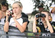 Steelers fans and siblings Lindsey and Brenden Kaldenberg of Slater, Iowa, watch the Pittsburgh Steelers practice.