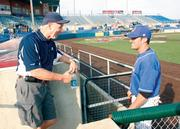Washington Wild Things outfielder Johnathan Erb stops to chat with season ticket holder John Chambers, 60, of Carmichaels, Greene County, prior to a game July 5, 2012. Chambers has had the same front-row seats next to the Wild Thing's dugout since the team's inaugural season in 2002.