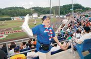 """Washington Wild Things usher Pat Swihart twirls a towel in an attempt to fire up the Consol Energy Park crowd during a game July 5, 2012 against the Rockford (IL.) Riverhawks. Swihart, who refers to herself as """"the crazy usher,"""" is in her first season working at the ballpark."""
