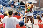 The Wild Thing, mascot of Washington's independent Frontier League baseball team, uses a water gun to provide young fans relief from high temperatures during a day game with the Evansville (IN.) Otters July 18, 2012.