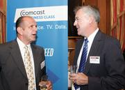 Bill Haniotes, left, of Comcast Business Services chats with Peter Mullen of No. 53 Wilke & Associates LLP.