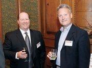 Chris Simchick, left, of SDLC Partners LP chats with Bob Markley of No. 4 Regulatory & Quality Solutions LLC.