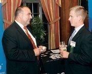Joe Scuilli, left, of Comcast Business Class chats with Chuck Nettles of Luttner Financial Group Ltd.