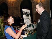 Kimberly Manns, left, of Luttner Financial Group Ltd. chats with Michael Gielata of No. 25 Stoltenberg Consulting Inc.