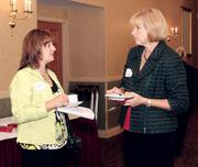Diane Fehl, left, of Stenger, Bies & Co. Inc., chats with Connie Genco of PNC Financial Services Group Inc.