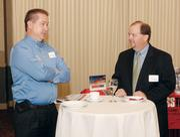 Thomas Bobik, left, of Bobik Bookkeeping, chats with Rork Ramfos of AmeriServ Financial Bank.