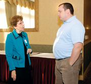 Rita Yunker of Colonial Life chats with Matthew Dixon of CMIT Solutions of Wexford.