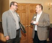 Regis McQuaide, left, of Master Remodelers, chats with Stephen Eckert of Eckert Marketing.