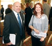John Goberish of Community College of Beaver County chats with Joy Heming of Professional Graphic Communications.