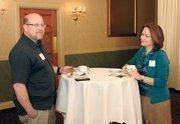 Joe Aiken of Mr. Sign chats with Cheranne Jurena of Benefits Network Inc.