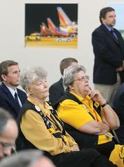 Airport Ambassadors Mary Garber, right, and Pat Diamond listen to speakers during the Pittsburgh International Airport 20th anniversary celebration. Diamond was one of the 54 original ambassadors when the volunteer program was established 12 years ago. Garber has been an ambassador for 10 years.
