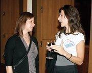 Gentech's Lori Krydick, left, chats with Lisa Balsamico of GT Nexus at Oktoberfest at Rivers Casino.