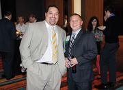 Vinnie Deleonibus, left, and Terry Franciscus of Ford Business Machines attend Oktoberfest at Rivers Casino.