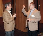 Dell's Tim Beamer, left, chats with Brad Hoover of Kelly IT Resources at Oktoberfest at Rivers Casino.