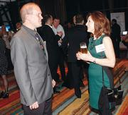 BBI's Tim Colcom chats with Ethan Allen's Patti Haake at Oktoberfest at Rivers Casino.