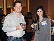 John Gillen of Gillen Co. LLC chats with Katherine Summerville of The Modern Matchmaker Inc. at Oktoberfest at Rivers Casino October 17, 2012.