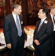 Craig Gaubert, left, of UPS chats with Joe Stromei of Dollar Bank.