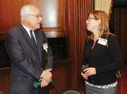 Harry Keefe of Sisterson & Co. LLP chats with Shelley Wood of Oglebay Resort & Conference Center.