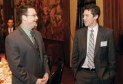 Nathanael Wilson of pair Networks, Inc. chats with David Hall of Gensler.