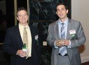 Tom Landau, left, of Landau Building Co. and Chuck Cieslak of Robert Half