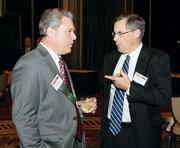 Larry Barger, left, of Alpern Rosenthal chats with Peter Blume of Thorp Reed and Armstrong LLP.