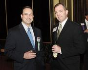 Jeff Kovacs, left, of Alpern Rosenthal chats with Martin Dorfner of Resources Global Professionals.
