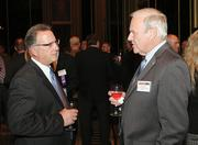 Charlie Riggs, left, of Shaft Drillers International LLC chats with Don Nestor of Arnett Foster Toothman PLLC.