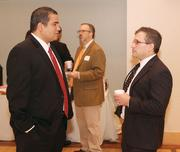 Omar Thrower, left, of Louis Plung & Company, LLP chats with James Holtzman of Legend Financial.