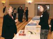 Monica Costanzo, left, of Ditto Document Solutions chats with Julia Johnson of Louis Plung & Co., LLP.