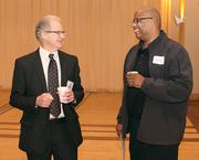 Earl Kaiserman, left, of Louis Plung & Co., LLP chats with John Blanton of Schneider's Dairy.