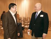Ed Lawrence, left, of Colliers International chats with Kevin Lynch of Belfor USA.