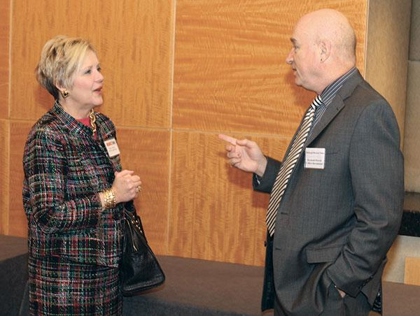 Debra Flinner of TriState Capital Bank chats with Raymond Orowetz of Colliers International at the Corridors of Opportunity luncheon Nov. 27, 2012, at the Hyatt Regency Pittsburgh International Airport.