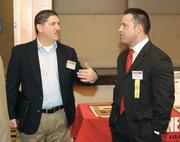Edward Palombo, left, of Peoples Natural Gas chats with Ryan Hayes of The Gateway Engineers Inc.