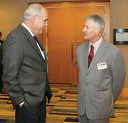 Donald Dempsey, left, of Dempsey Site Management Services LLC chats with Gregg Schwotzer of Crossgates Inc.